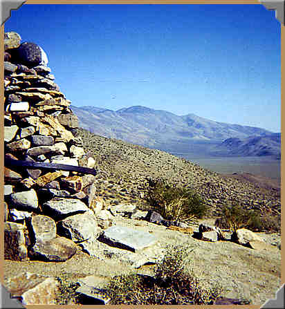 Carl Mengel cairn, looking Eastward into Striped Butte Valley - 10/1976